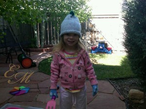 Maddy suited up to work in the garden.