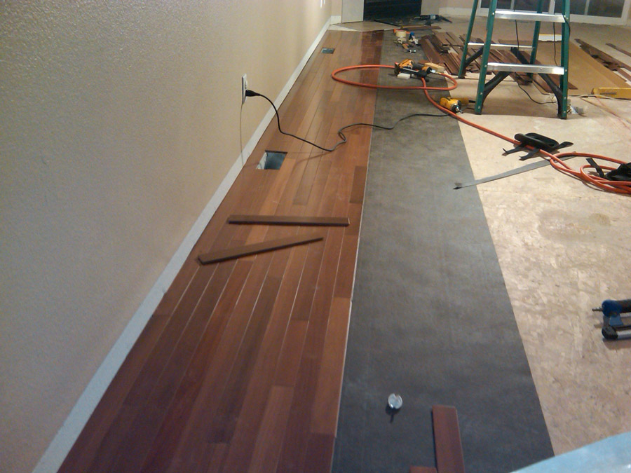 How to install wood floors in your living room evolving for Laying hardwood floors