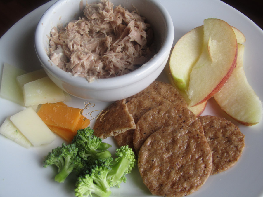 Kid Lunch with Tuna, crackers, apple slices, cheese and broccoli.